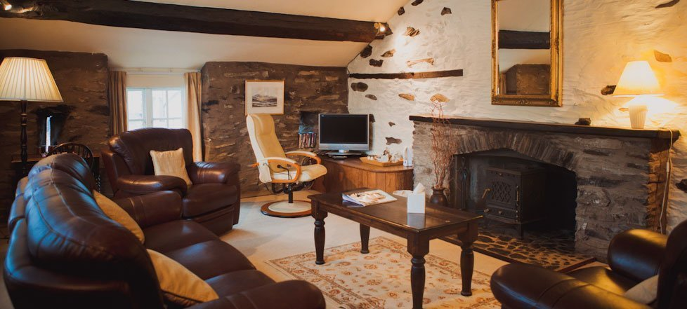 The lounge area of a suite at The West Arms, Llanarmon Dyffryn-Ceiriog
