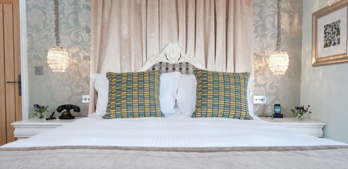 A luxurious bedroom at the Wild Boar Inn